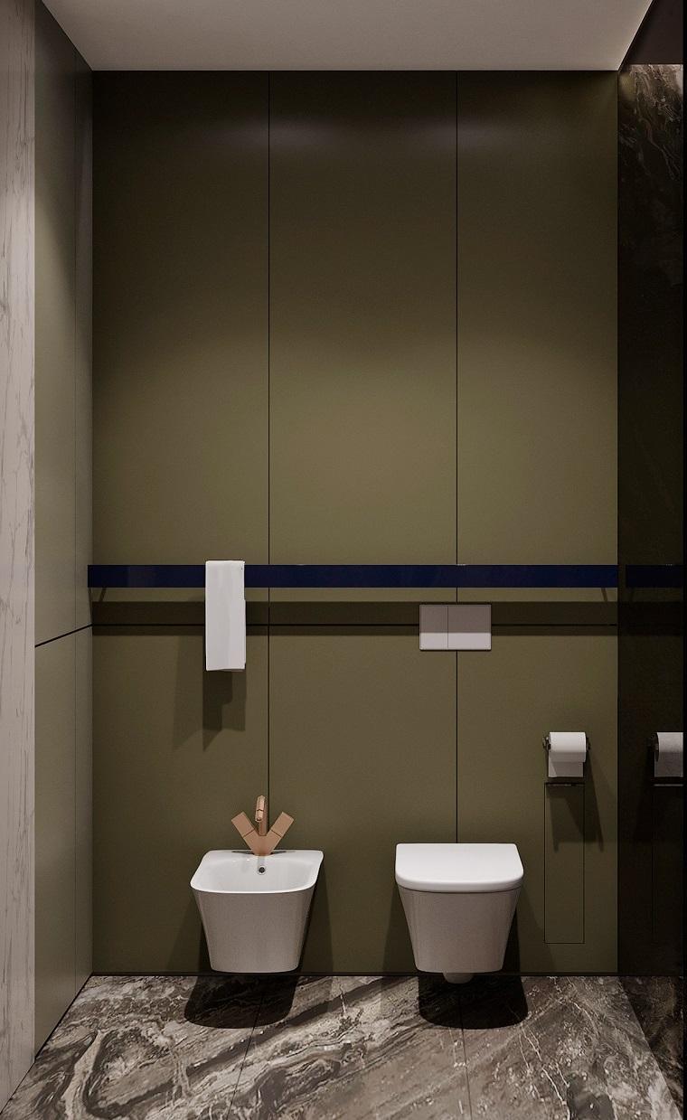 Sala da bagno con parete colore verde, rubinetteria di colore oro, rivestimenti bagni moderni immagini