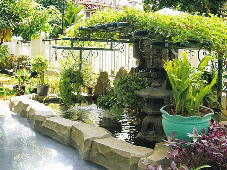 progettare un giardino piante pietre fontana