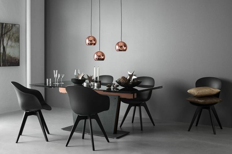 sala con tavolo da pranzo in vetro sedie di colore nero con cuscini