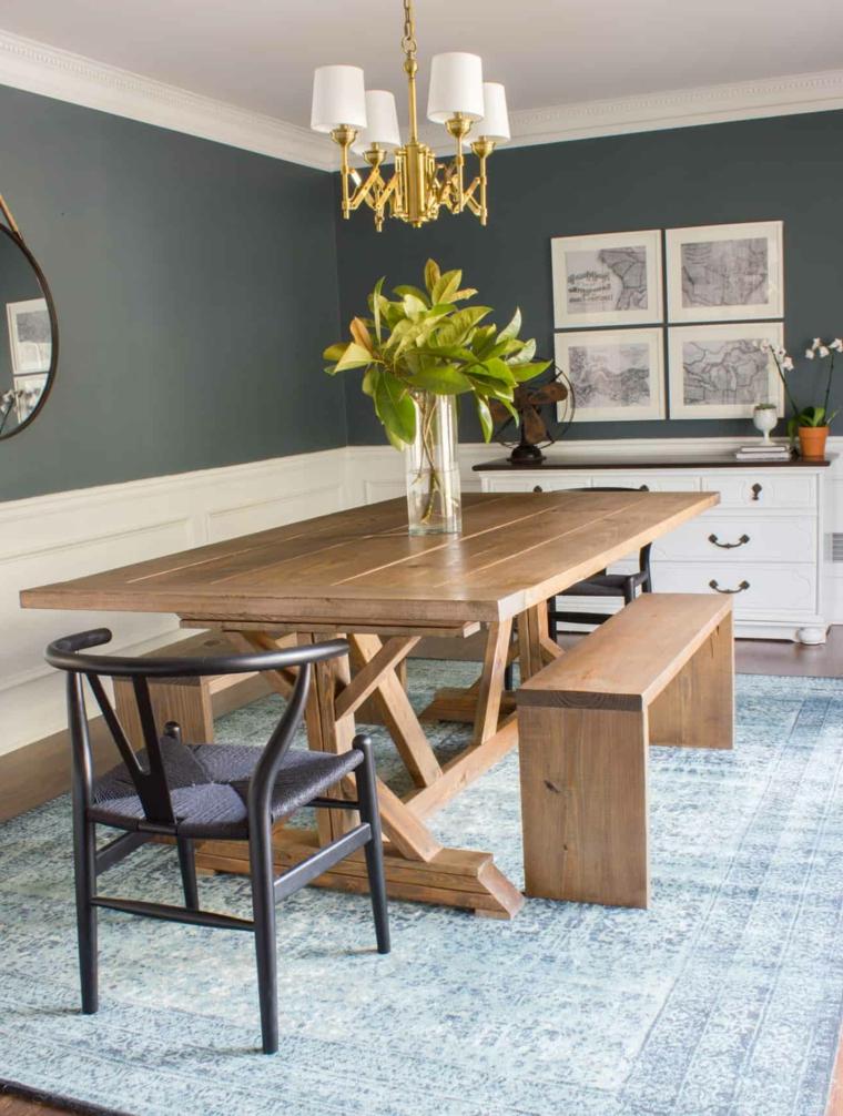 sala con tavolo di legno rettangolare panchina e sedia di colore nero