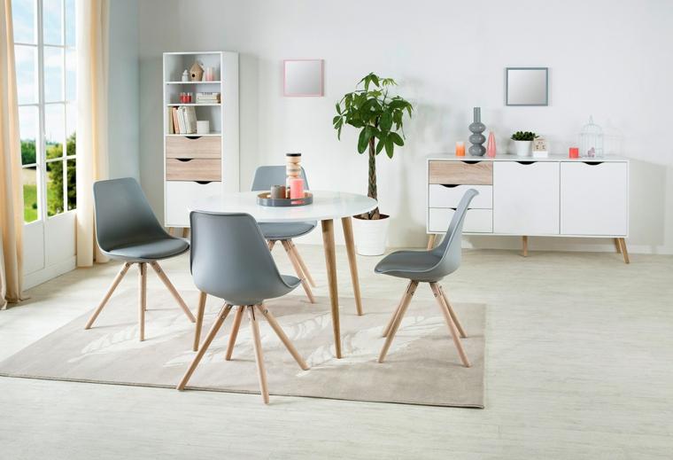 sala da pranzo moderna tavolo rotondo con sedie stile nordico grigie