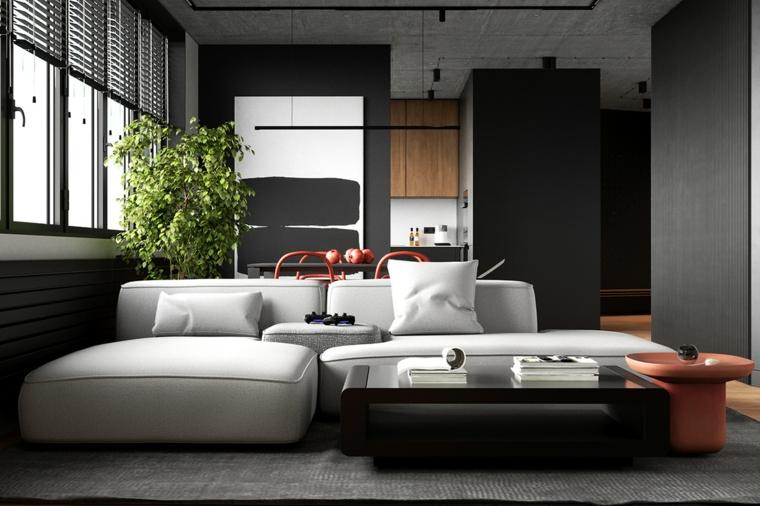 Divano angolare accanto ad un tavolino, soggiorno con pareti grigie