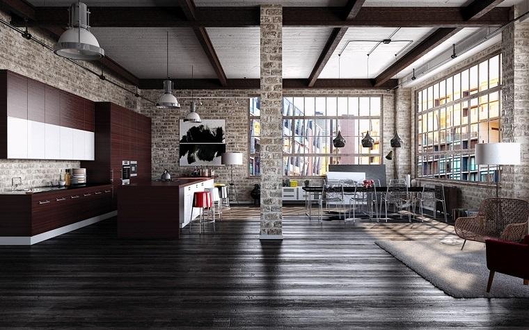 stile industriale loft ampie vetrate pavimento legno