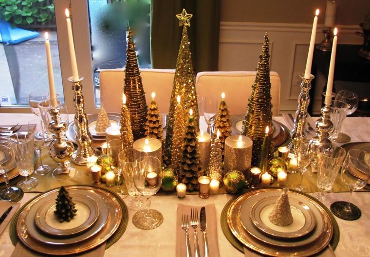 tavolo decorato tante candele pigne