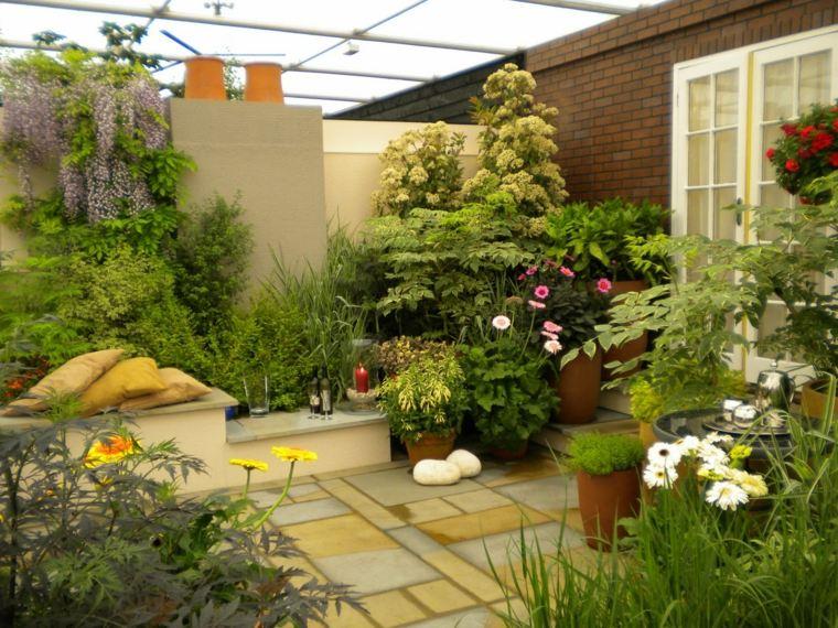 terrazzi moderni coperti pieni piante stagionali
