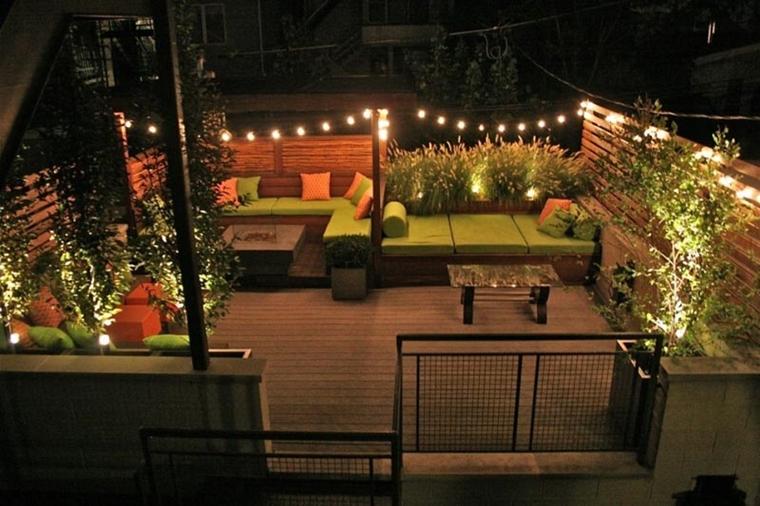 terrazzi moderni tetto decorate piante luminarie