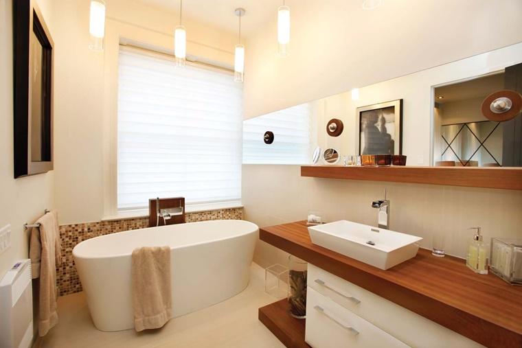 vasca freestending forma ovale superficie mobile legno