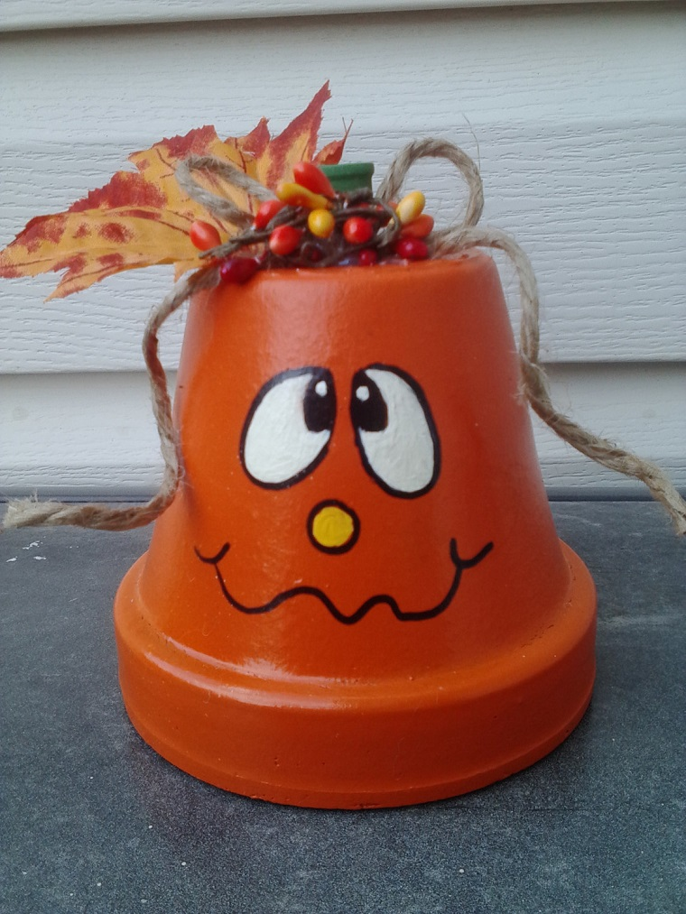 vasi di terracotta faccia simpatica