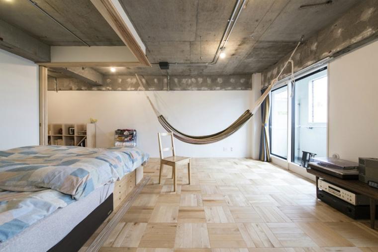 amaca sospesa camera letto grande stile industriale