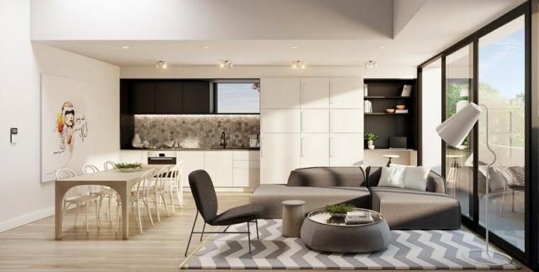 Open space soggiorno cucina progetti, divano di colore grigio, paraschizzi cucina colorato
