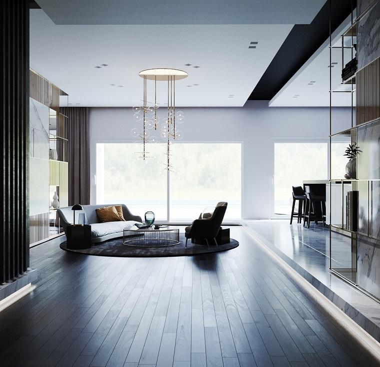 Open space soggiorno cucina progetti, divano grigio angolare, stanca con pavimento in parquet