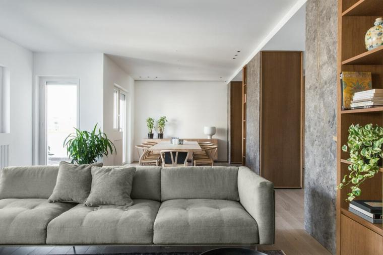 Soluzioni per dividere soggiorno e cucina, divano di colore grigio, tavolo con sedie di legno