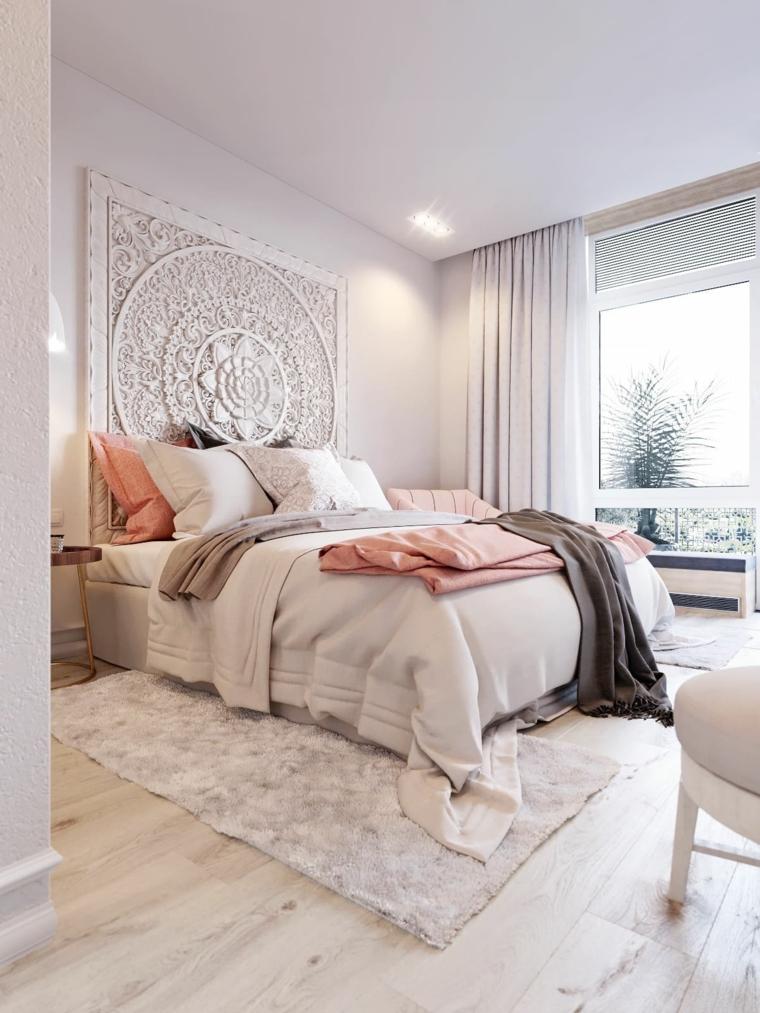 camera da letto piccola testata pannello cuscini tappeto finestra tende poltrona