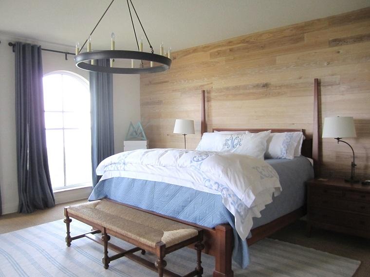 camera letto pannello legno stile rustico