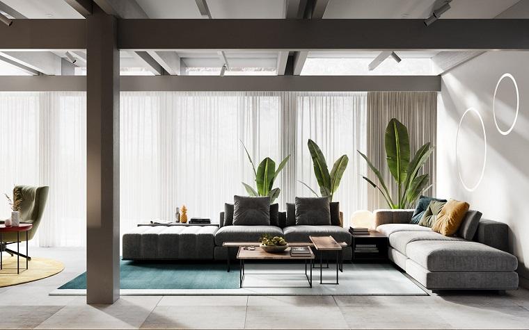 Divano grigio angolare, soffitto con travi di legno, arredare salotto e sala da pranzo insieme