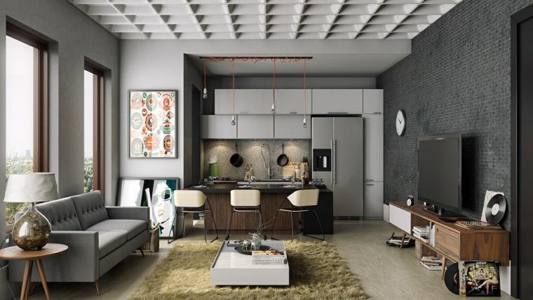 Cucina con isola centrale, loft significato, divano in tessuto grigio, mobile tv in legno