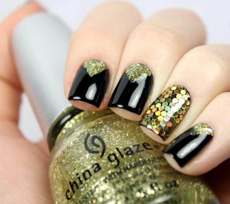 manicure moderna nero brillantini tema natalizio