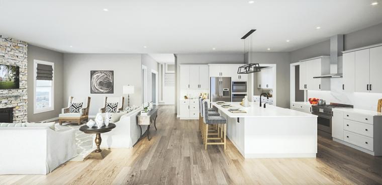 Cucina con isola centrale, soggiorno con divano, pavimento in legno, parete effetto pietra