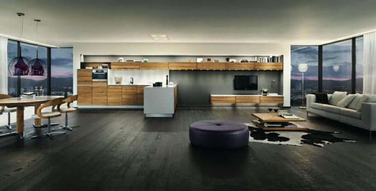 Cucina con isola laterale, divano di colore grigio, loft significato, tavolo da pranzo rotondo
