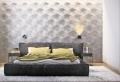 Stanza da letto moderna con parete di design speciale dietro il letto