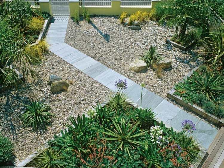 progettare giardini piante sempeverdi ghiaia stradina lastre marmo
