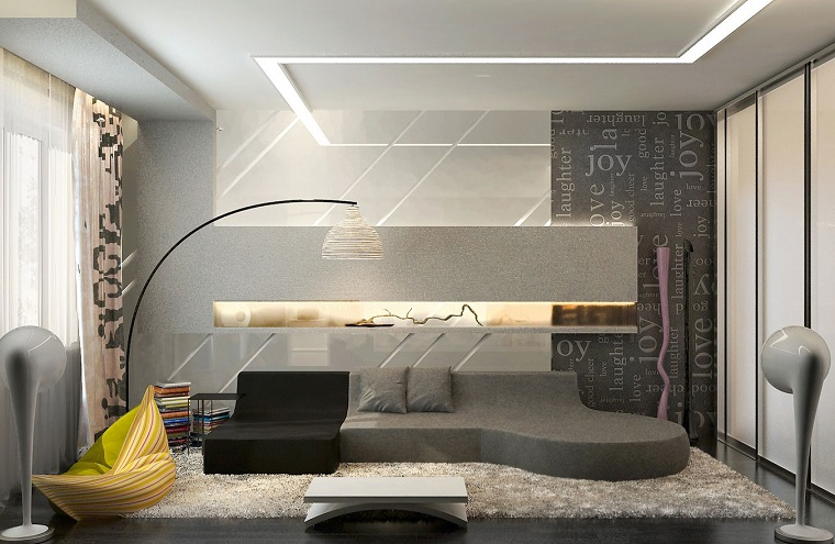salone moderno divano grigio parete scritte