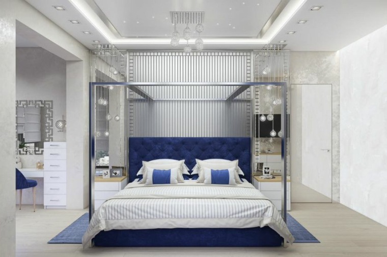 stanza da letto moderna testata blu pannelli parete comodini tappeto cuscini