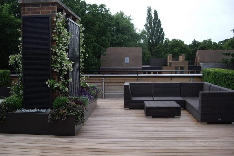 arredamento terrazzo tonalita scure linee moderne