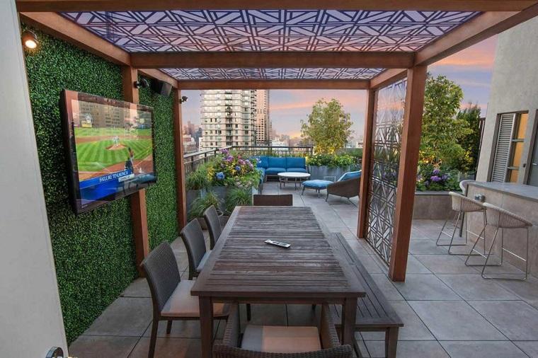 arredamento terrazzo zona pranzo pergola legno