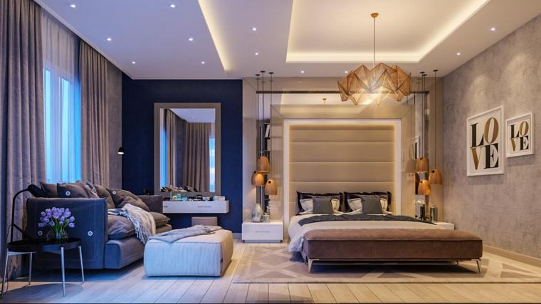 Colori camera da letto, zona notte con divano, pareti colorate grigio e blu, lampadario sospeso