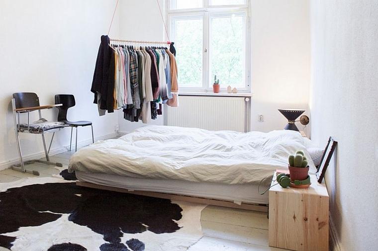 arredare camera da letto stile scandinavo tappeto pelle mucca
