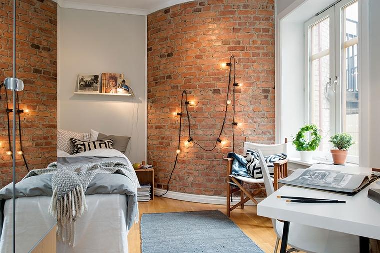 arredare la camera da letto parete mattoni vista