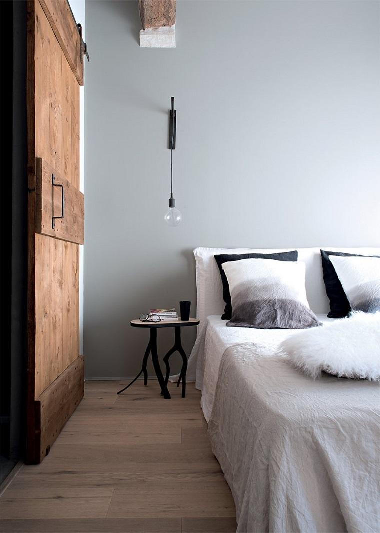 camera letto porta legno scorrevole pareti grigio