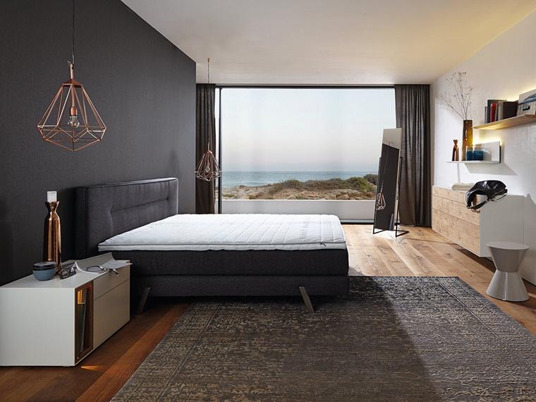 camere da letto moderne parete scura pavimento legno
