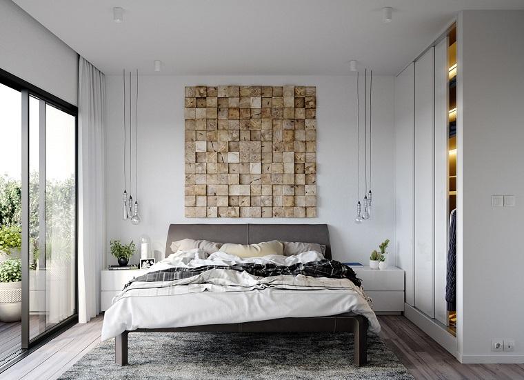 Come abbellire camera da letto, parete con mattoni, lampade sospese, tappeto peloso grigio