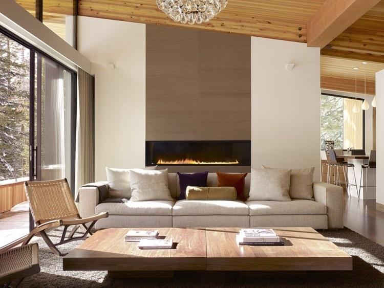 caminetti moderni parete divano coperto cuscini soggiorno