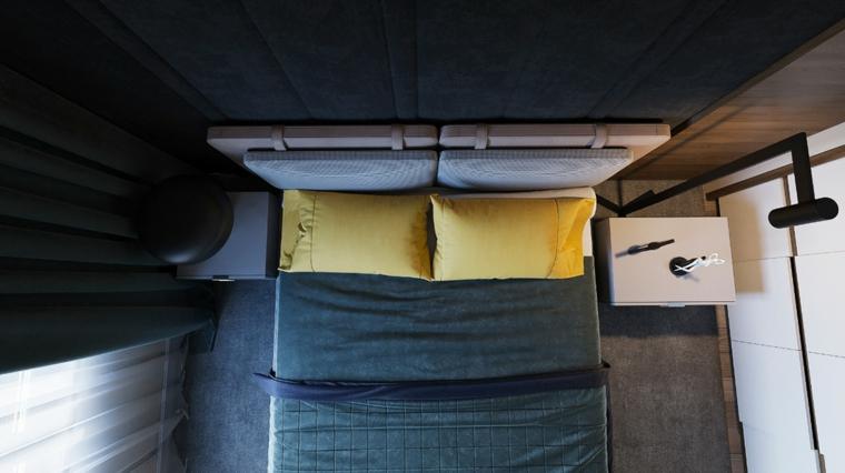 Come arredare una camera da letto piccola, testata letto con cuscini, pareti con pannello in legno