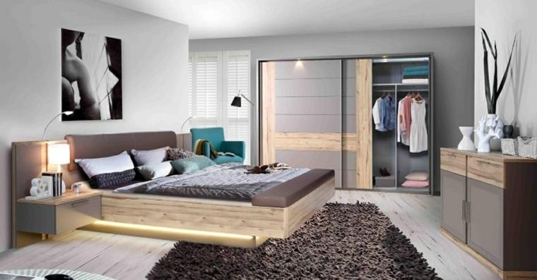 Armadio con porte scorrevoli, letto con illuminazione, comodini in sospeso, tappeto peloso grigio
