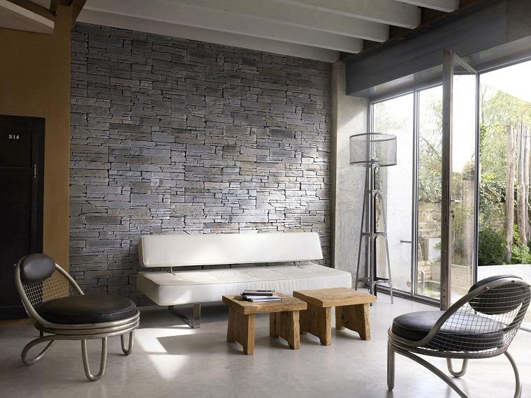 mattoni a vista parete soggiorno