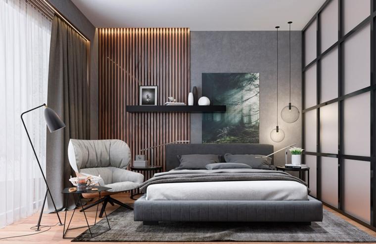 Zona notte con cabina armadio, letto con testata grigia, pannello in legno sulla parete