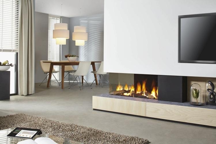 Caminetti moderni nel soggiorno 18 idee che tolgono il for Parete attrezzata con camino