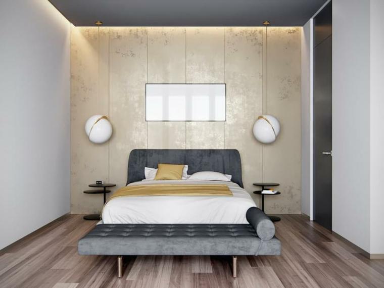 Zona notte con parete in marmo, lampade da parete rotonde, pavimento in legno