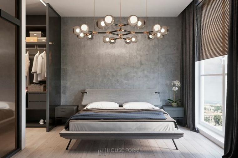 Zona notte con finestre, cabina armadio a vista, letto con testata in legno, parete di colore grigio