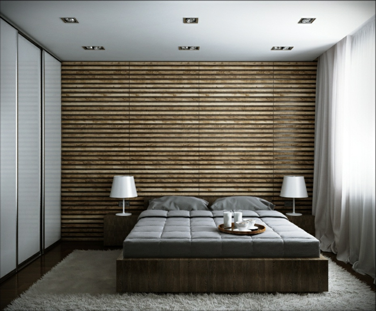 Zona notte con parete in legno, letto in legno, soffitto con faretti, tappeto bianco peloso