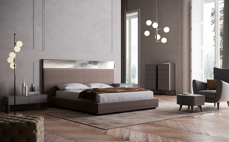 Colori camera da letto, pavimento in legno, poltrona con tavolino, letto con testata