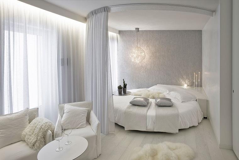 pareti grigie camera design moderno letto rotondo