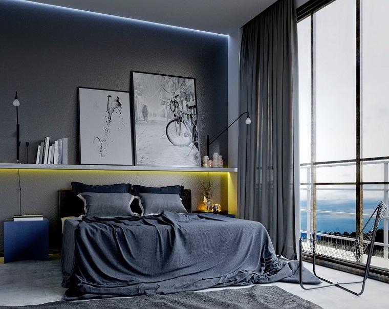 pareti grigie stanza letto moderna