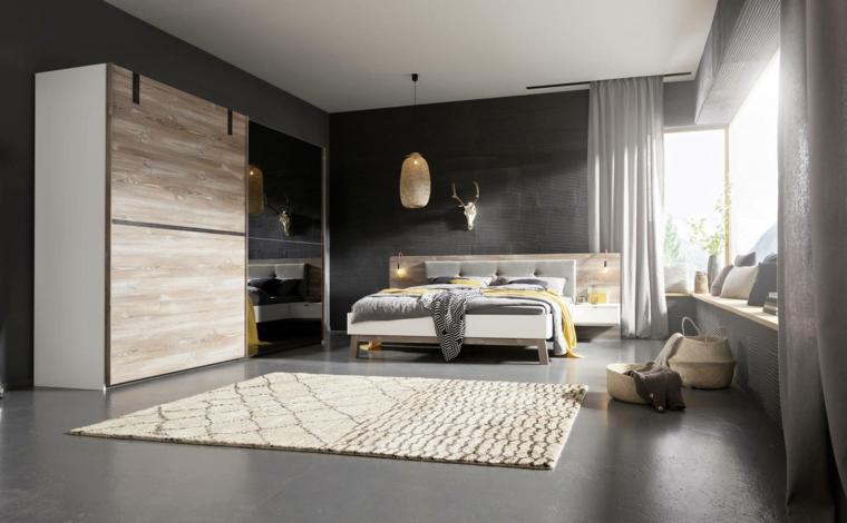 Camera da letto con pareti grigie, armadio con porte scorrevoli, letto con testata in legno
