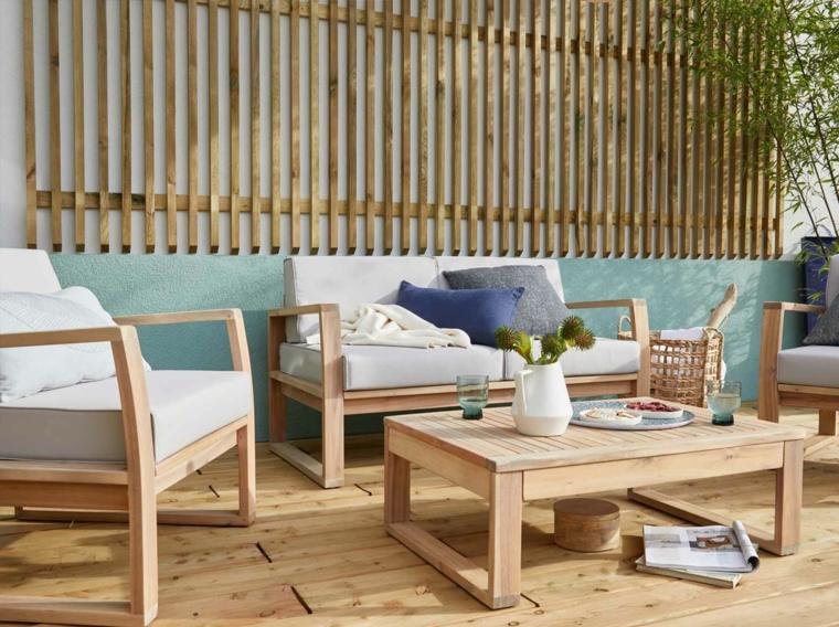 Come arredare un piccolo terrazzo coperto, set di mobili dicano e tavolino in legno