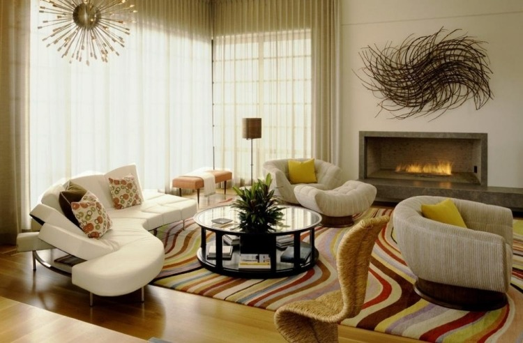 soggiorno moderno arredato stile camino parete decorazioni particolari